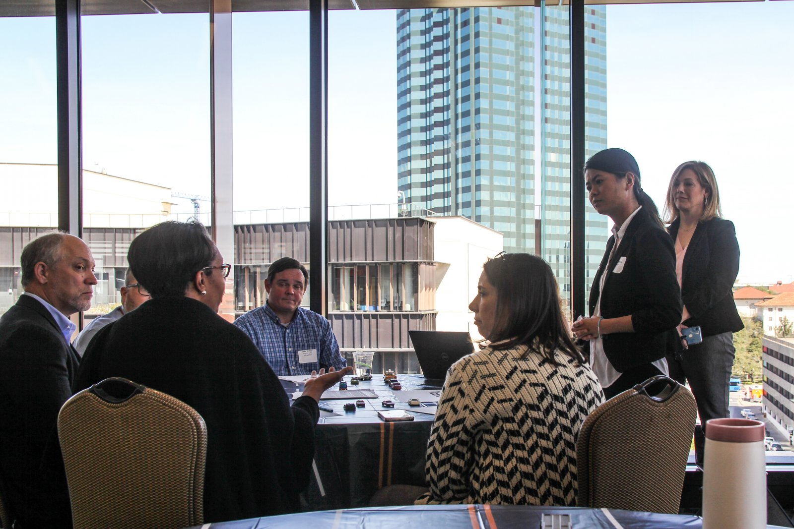 meeting with diverse group of UT Austin leaders, Austin city skyline in background